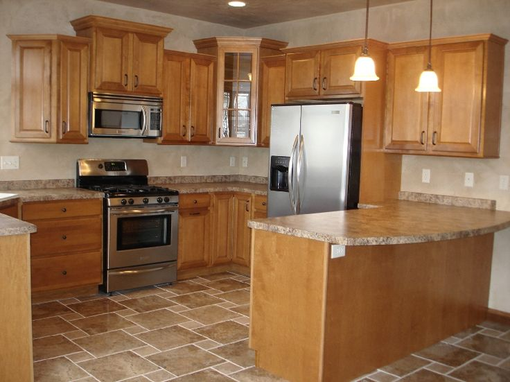 Kitchen Design With Oak Cabinets And Stainless Steel Appliances This Kitchen Boosts Tile Floors And