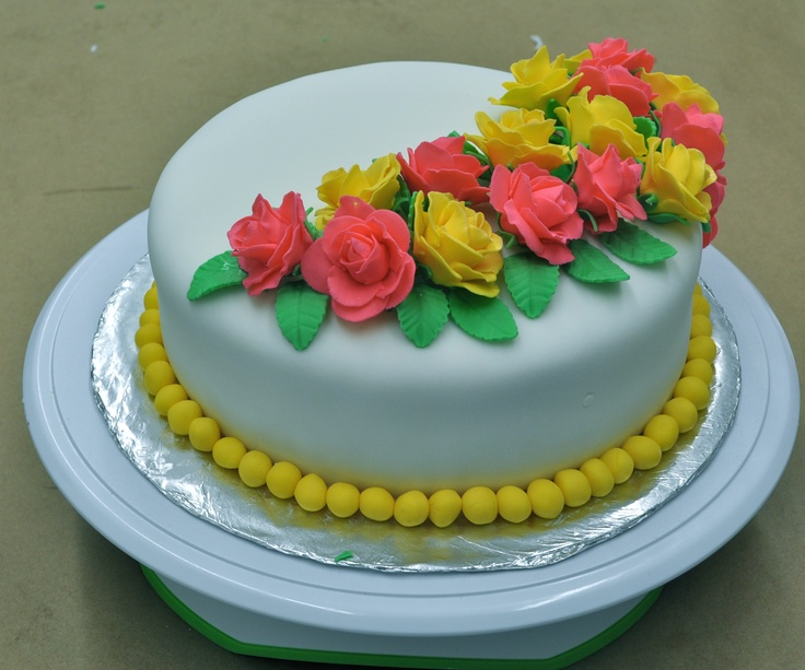 Cake Decorated with Red and Yellow Roses!