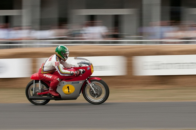 Giocomo Agostini on an MV Agusta at Goodwood. The sound and smell is magical and terrifying at the same time. Check yourself with a magnet before thinking of racing this machinery - apparently you need balls of steel. The closest I will come is owning the replica Agostini AGV helmet. I look the bees knees in it.
