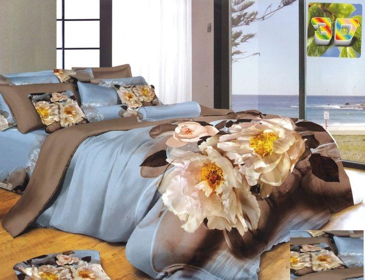 Elegancka niebieska pościel do sypialni w kremowe kwiaty