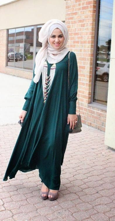 hijab styles interesting combination of long green dress with satlara jewelry