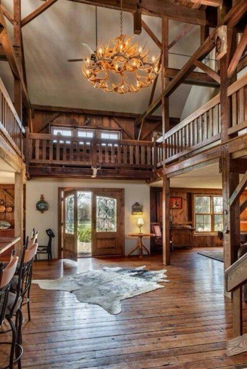Neat Wrap-Around Balcony In This Log Home.