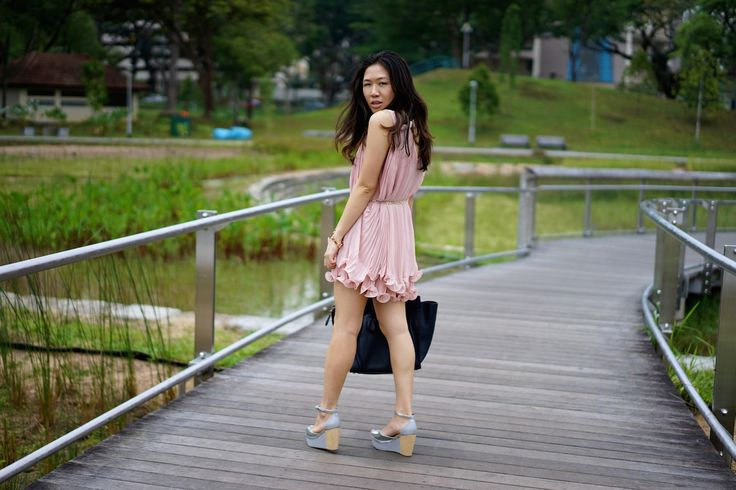 Ministry of Retail Frilly Hibiscus Dress, Venilla Suita peep-toe silver and wood ankle-strap wedge sandals, Céline Mini Luggage Tote and Luv Aj Pyramid Stud Tennis Bracelet in Shiny Rose Gold