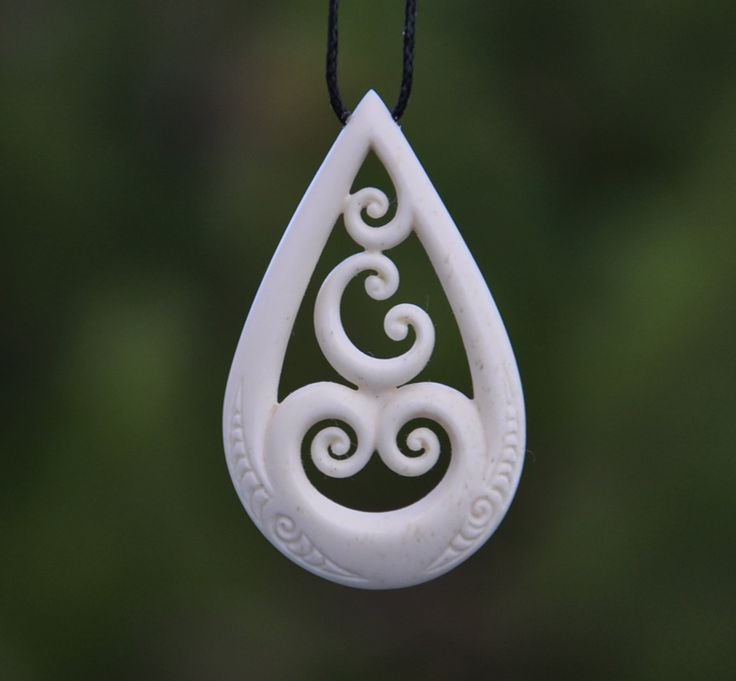 Family of five- Maori symbol for family,unity & love. Hand carved in bone by JackieTump on Etsy