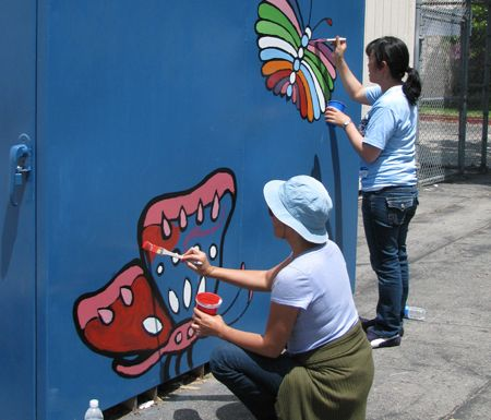 School mural project. || Clicking the image will take you to a blog post about the project. || Butterflies inspired by Alebrijes. I designed and directed, volunteers brought the elbow grease and LOVE. || That's my landlady in the foreground :-)