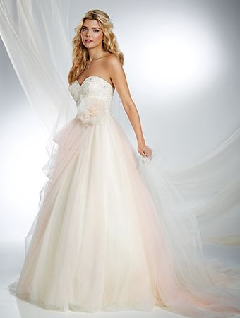 2016 DISNEY PRINCESS COLLECTION by Alfred Angelo.  Princess: SLEEPING BEAUTY.  Lush layers of tulle delicately swathe this soft and romantic Disney bridal dress. A handmade flower at the waist is reminiscent of Sleeping Beauty's woodland childhood as Briar Rose.