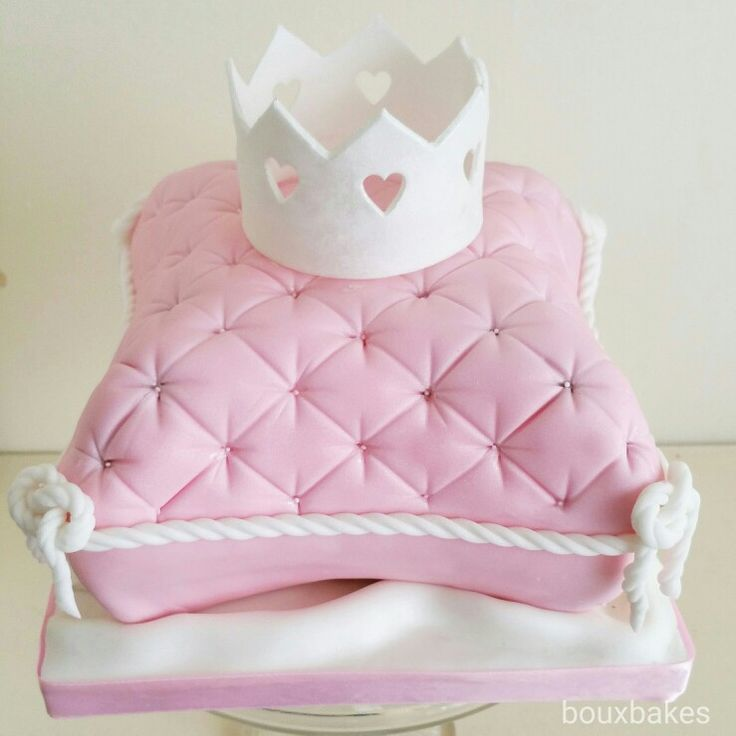 Pink and white pillow cake topped with heart crown