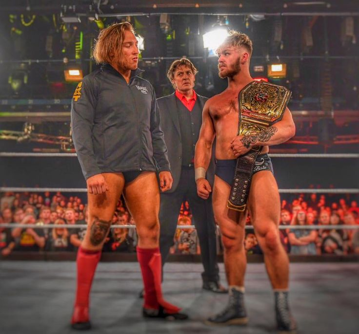 Pete Dunne, William Regal and Tyler Bate