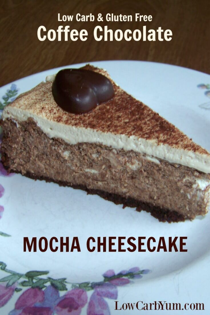A decadent coffee chocolate mocha cheesecake recipe to wow your low carb friends. It uses homemade gluten free chocolate biscotti that have been ground up for the crust. | LowCarbYum.com