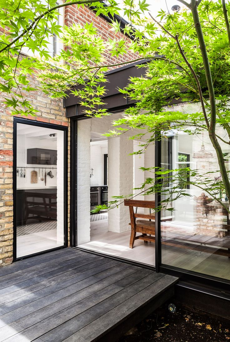 Courtyard House by Kirkwood McCarthy. The property, now named Courtyard House, had previously been extended at the rear. This created a kitchen with small windows, but meant the garden could only be accessed through a small conservatory.#homedecor #homeoffice