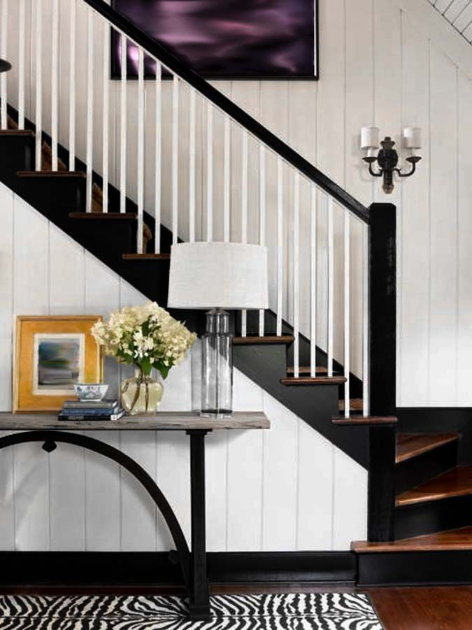 Black painted handrail, baseboards, risers and wood stained treads.