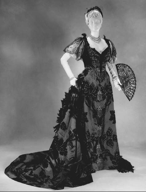 Haute couture evening dress, circa 1894. Dresses designed by the House of Worth, one of the first couture houses, were known for their luxurious textiles and were worn by wealthy society ladies. This Worth dress was worn by the wife of re-known architect Stanford White.