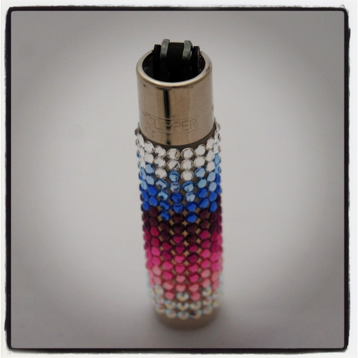 Swarovski Crystallized Clipper Lighter £15.00 http://www.diamontedecor.com/product-p/lightermix.htm Refillable Clipper Lighter hand decorated with Swarovski Crystals. Fade in and out design using a mixture of colours. Be the envy of your friends when you pull out this sparkly gorgeous lighter. Note: The actual colour of the Clipper lighter may vary to those in the pictures but will always match the crystal colours.