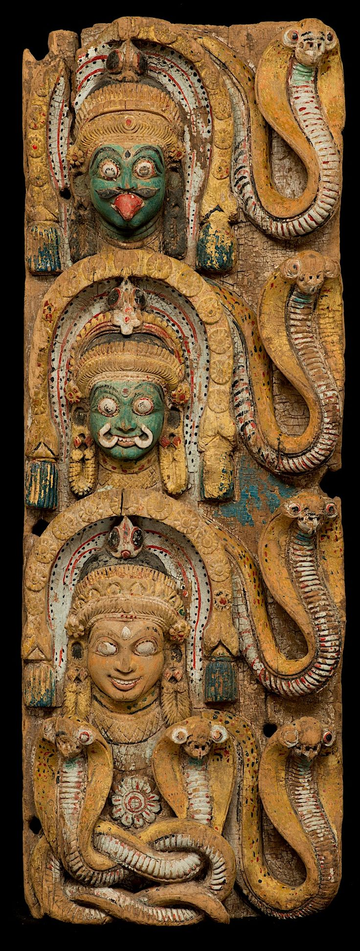 Wooden Doorframe or a Temple Chariot with Naga (Serpent) Protectors assoc. with Shiva. India, Tamil Nadu or Kerala 18th C. Wood with pigment.