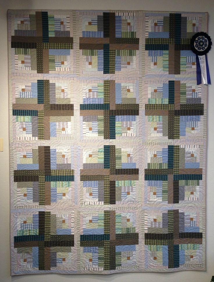 Made from thrifted shirts: Crop Circles quilt (off-center log cabin) by Cherie at Quilted Jonquil. Judges Choice award, 2015 Quintessential Quilt show. Quite a few of the shirts were from the Goodwill Clearance Center for $0.79/lb.