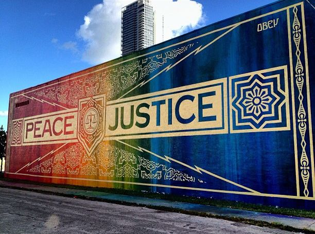 peace justice street mural by Shepard Fairey.