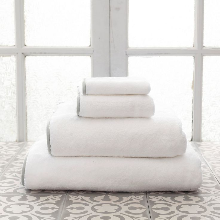 """A superabsorbent, luxurious cotton bath towel is punched up with a single band of subtle grey.   Made to coordinate with our  Signature Pearl Grey bath rugs,  Trio Pearl Grey bedding and  Stonewashed Linen Pearl Grey bedding.  • 100% cotton.  • Banding 100% polyester  • 1/2"""" band on all sides. pine cone hill annie selke"""