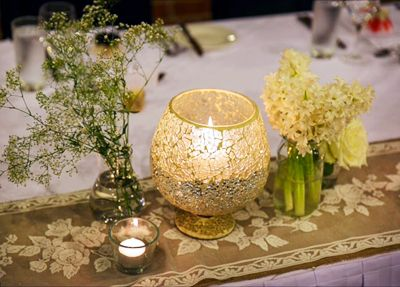 Our Hired 'Vintage Rose' table runners look devine and set the scene to romantic with beautiful mercury glass candles and wildflowers http://www.marrighi.com.au/Wedding-event-decor/Table-Runners.html