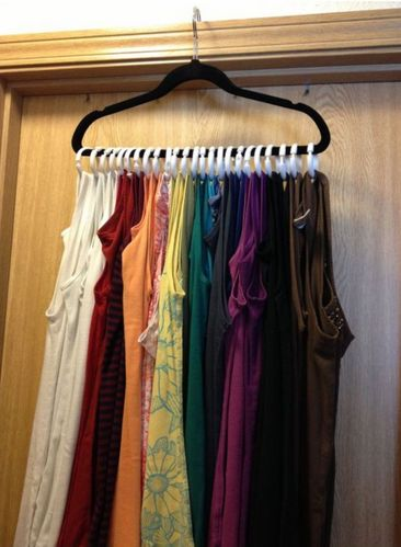 When I saw this idea pop up on Pinterest, I couldn't resist trying it out. I already had a custom made scarf hanger, which saves tons of drawer space and provides wrinkle free scarves, so this was a no brainer.There are a few different methods out there using everything from hangers and shower curtain clips