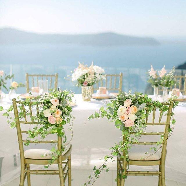 Favorite wedding chairs Vol.5  Greenery perfection on gold chiavari  Photography: @annaroussos  Florals : @bettyflowerssantorini  Venue: @santoriniweddings #weddingchairs #Greenery