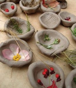 Textures from nature...ball up the clay and make a pinch pot, use a hump mold or have students press the ball of clay onto their knees and mold into a bowl shape.