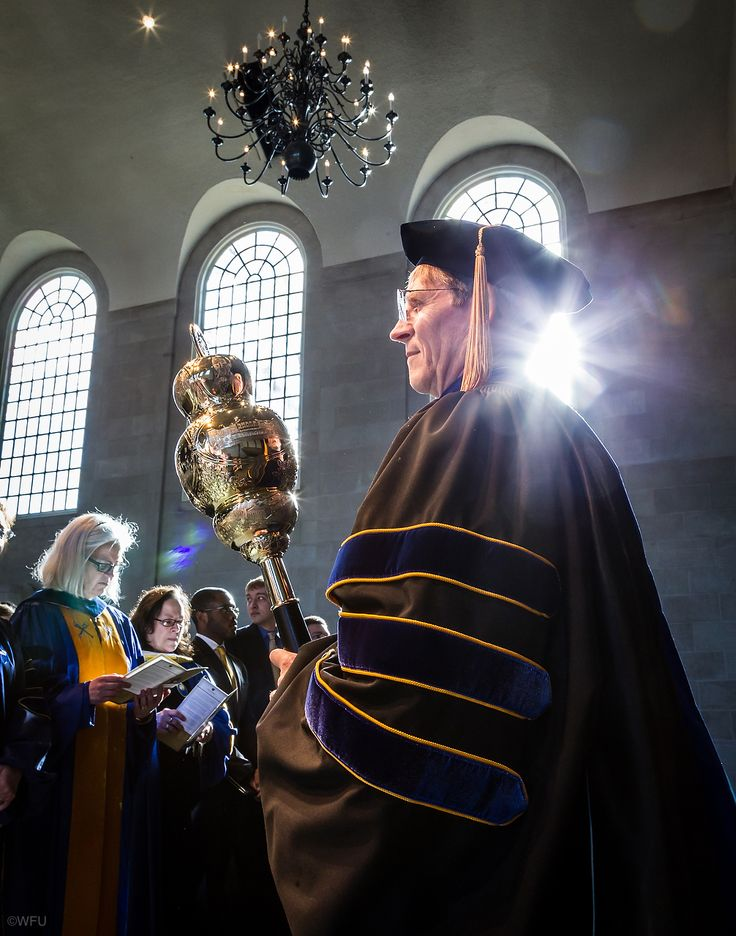 #WFU | CONVOCATION: Wake Forest medical school professor Daniel Bourland carries the mace in the processional during Founders Day Convocation in Wait Chapel on Thursday. -Ken Bennett | #photo