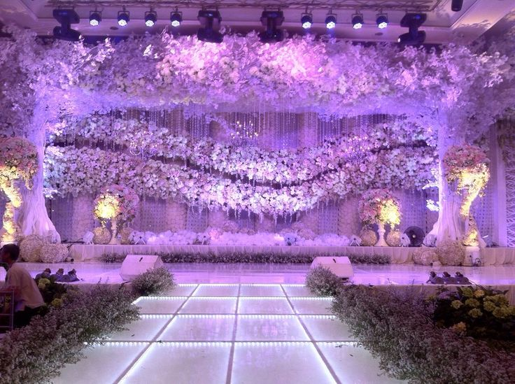 Feels like in a magical world with this flowery setting for your wedding altar | Project by Dawid Daud Decoration http://www.bridestory.com/dawid-daud-decoration/projects/wedding-decoration1432608932