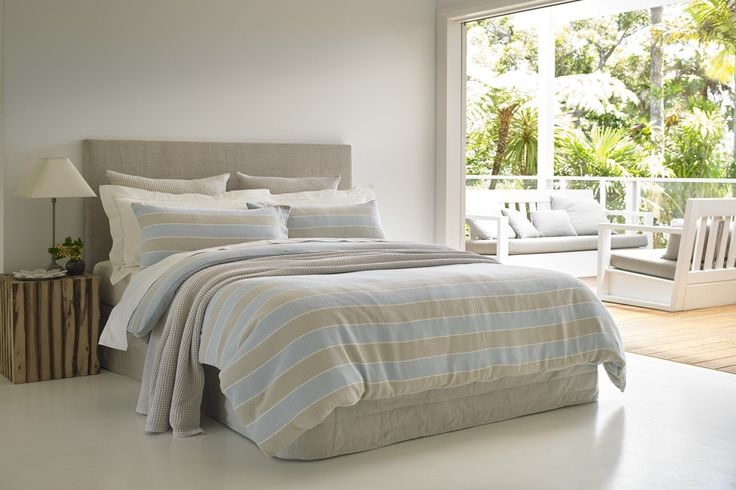 100% Cotton, yarn dyed jacquard horizontal striped duvet cover set in blue and latte. Includes matching standard pillowcase(s).