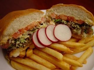 Torta :Mexican roll bread stuffed with your choice of meat. Mayonnaise, beans, lettuce, tomatoes, onions, sour cream, cilantro & avocado from Pico Pica Rico Restaurant in Los Angeles #Food #Torta #Restaurant forked.com