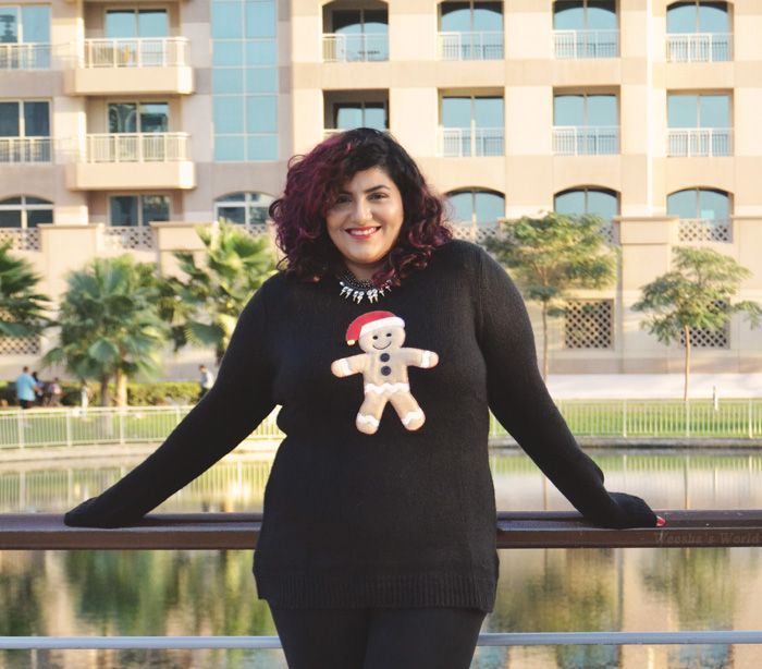 Weesha wears plus size christmas sweater from New Look