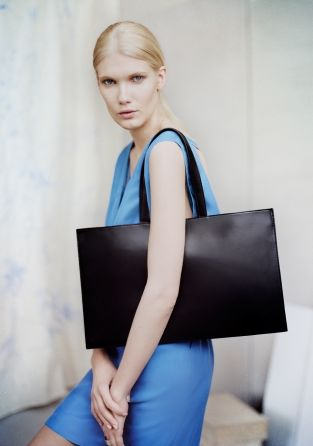 Made from textured leather, this tote has a clean and structured design.