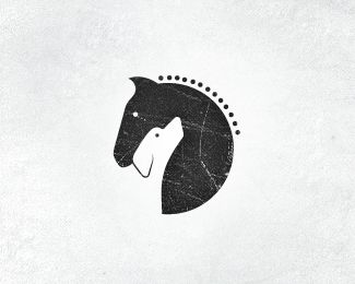 logo for horse stables & dog training center. Great combination of both elements. The dark color of the horse is extremely effective when looking at the light colored dog. Moreover, the crackled grey look and dots for the mane give the horse a bold, classy and sophisticated appearance. This logo met the needs of the design!