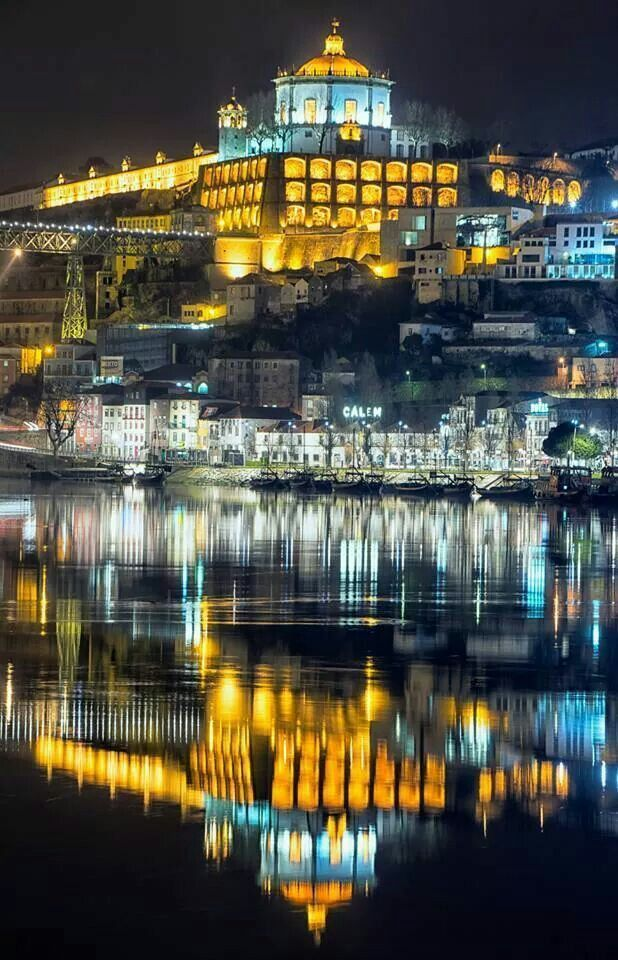 Porto by night reflected on the Douro River #Portugal