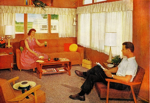 1950s living rooms. Sometimes this stuff makes me really want to live back then. Look at him, reading the paper! And if were here, the next thing I'd do is lie across that sofa with a book. No internets.