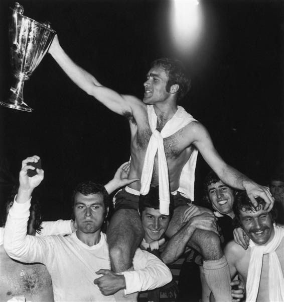 21 May 1971: CHELSEA captain RON HARRIS holds aloft the EUROPEAN CUP WINNERS' CUP after his team beat Real Madrid 2-1 in a replay at the Karaiskaki Stadium in Athens. Left with his arm raised is KEITH WELLER, right is CHARLIE COOKE, and next to him is PETER BONETTI...