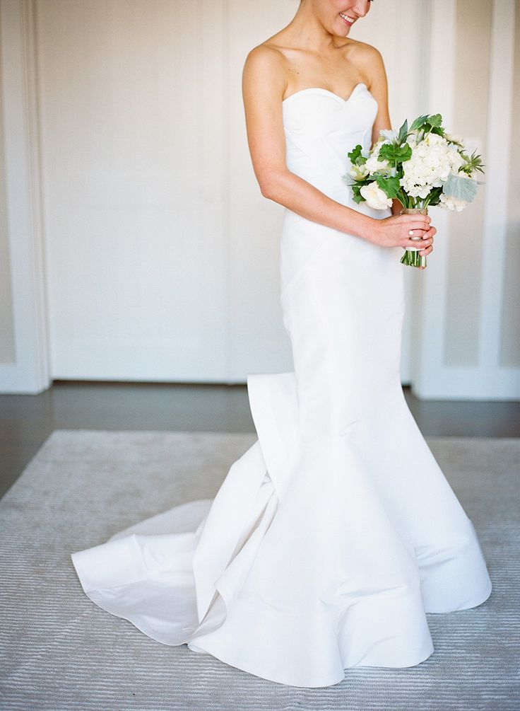 A sleek and strapless silhouette is chic and timeless: http://www.stylemepretty.com/2015/08/25/classic-wedding-details-that-stand-the-test-of-time/