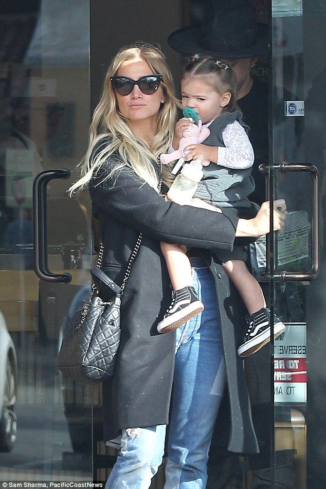 Mother and child: Ashlee Simpson cut a stylish figure in cat-eye sunglasses when she stepped out in Thursday, her one-year-old daughter Jagger in her arms