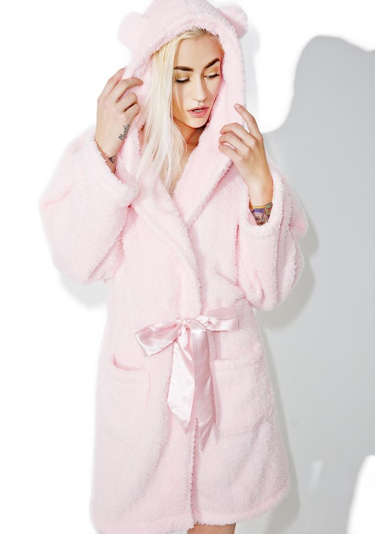 Cuddly Cub Fluffy Robe we wouldn't mind hibernating thru the winter with you, bb~! This adorable robe features a suuuper plush baby pink construction, cozy slouchy fit, front pockets, satiny drawstring waist ties, and a comfy hood with lil bear ear details.