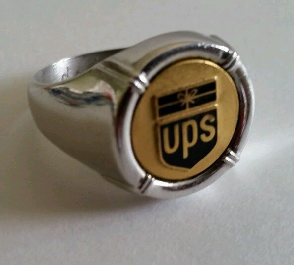 Vintage (UPS) Employee Award United Parcel Service Ring, marked Ster. (Sterling), unmarked for gold content, Has Engraved Initials J.E.A.? Large, heavy, size, 13 3/4 on sizer, Enameled logo center may be gold but untested.