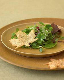 For a Canada day party-As if a golden maple leaf had alighted on a field of green, these savory crisps evoke fall. Shaped with a cookie cutter, the leaves are made from wonton wrappers that are seasoned with herbs and Parmesan cheese, then baked. Serve as a cocktail-hour nibble or with salad as a crouton substitute. (Cookie cutter from Kitchen Krafts.) From Martha Stewart Could do tortilla chips too...hmm.