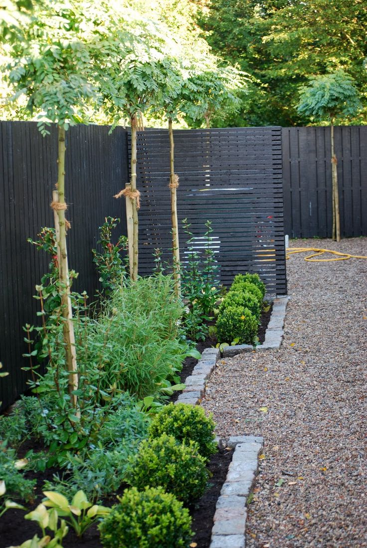 More strain lines & less corners but I like the dark fence tall greenery & river rock