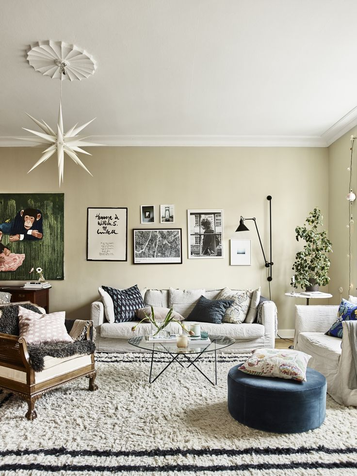The livingroom of Johanna Bradford, with a lovely art wall and great furniture and carpet.