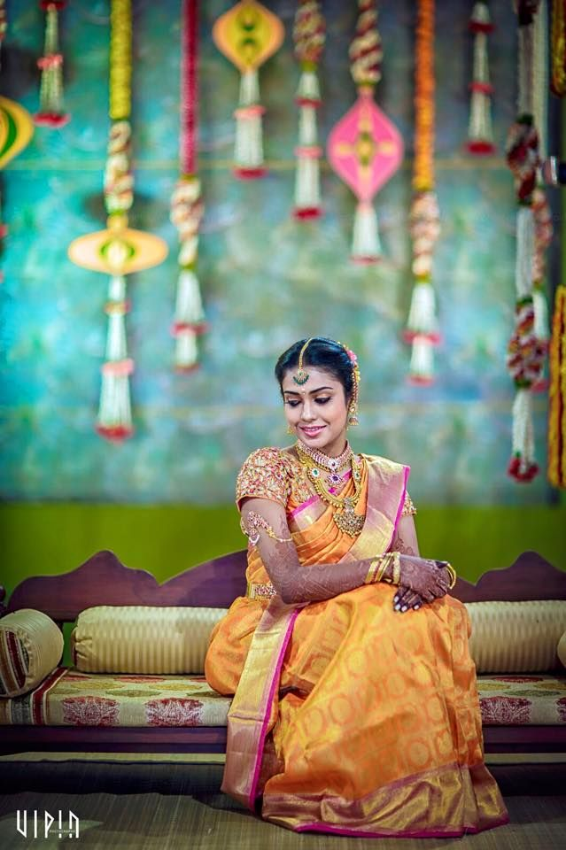 South Indian bride. Temple jewelry. Jhumkis.Yellow and pink silk kanchipuram sari.Braid with fresh jasmine flowers. Tamil bride. Telugu bride. Kannada bride. Hindu bride. Malayalee bride.Kerala bride.South Indian wedding