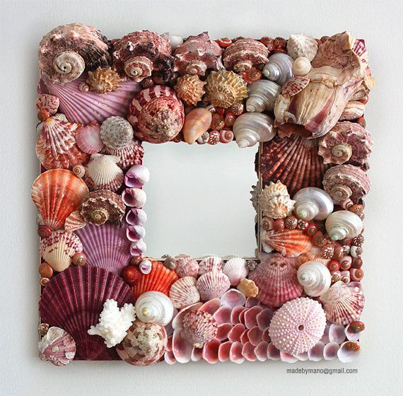 Really overpriced. Handmade seashell mirror covered in exotic pink by madebymano, $575.00
