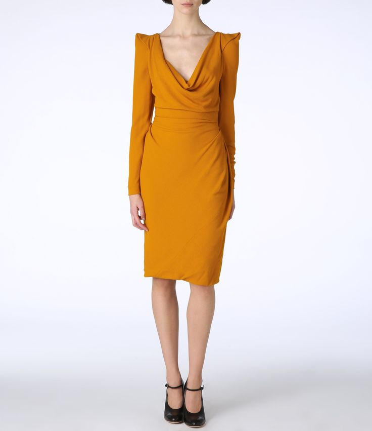 Saffron Short Amber Dress: Bold and block.  A great statement on it's own, but with a funky bag like the Vivienne Westwood Squiggle music bag with accents of the same colour you can inject fun.