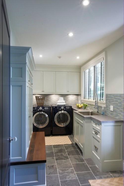 Laundry room - good lighting, nice backsplash tile, nice tile floor. Cool sink.