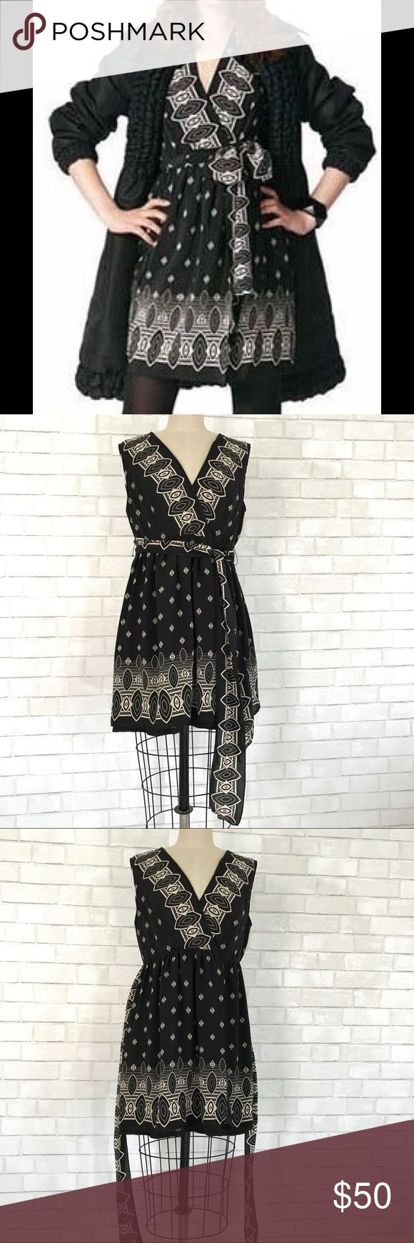 Silk Wrap Dress Anna Sui for Target Printed black silk wrap dress by Anna Sui for Target  Size L, 100% Silk full under lining 100% Polyester. Wrap dress, attached belt. V neck, sleeves, full skirt. New never worn no tag.   Ⓜ️Chest 38 Ⓜ️Waist 32 Ⓜ️heel Skirt 19 Ⓜ️Length 34  ✅Bundle and save  ✅🚭 🚫No Trading 🙅🏻 Poshmark rules only‼️ Anna Sui Dresses