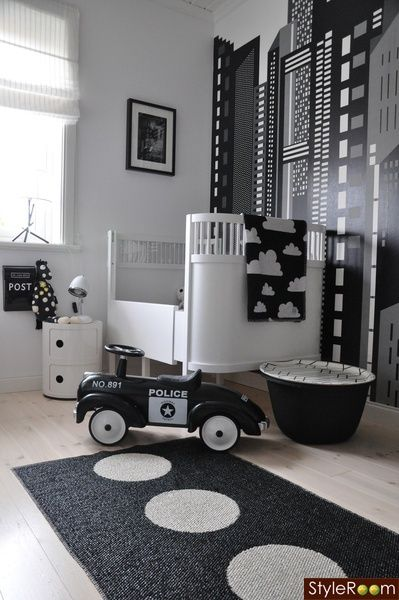 love love love love love!!!!!!    styleroom.se    Fun, contemporary white  black boys nursery design with white modern crib, white  black cityscape wall mural, white  black could blanket, white  black circles runner and white  black toy police car.