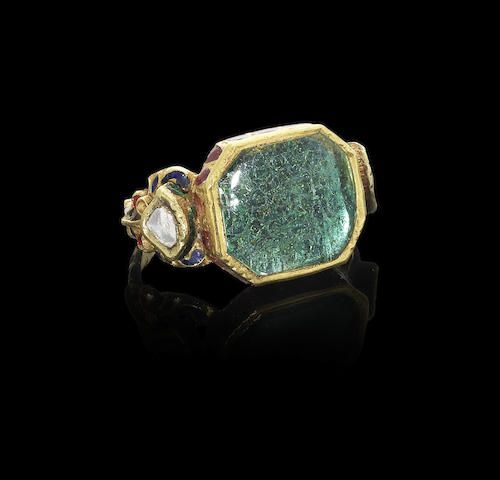 An emerald and diamond-set enamelled gold ring North Indian or Deccan, 18th Century