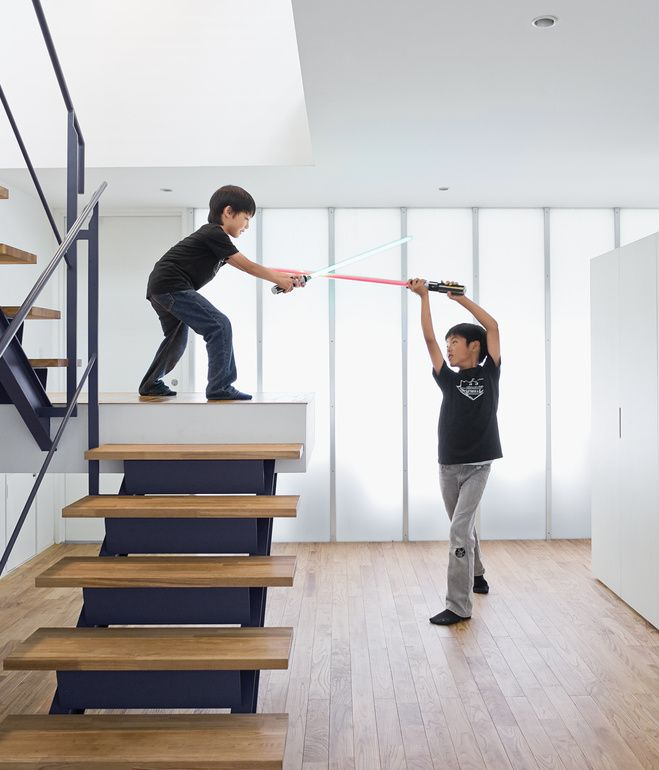 The open-tread stair leading from the garage to the second-floor living room sets the stage for a Star Wars–style duel.  Photo by Dean Ka...